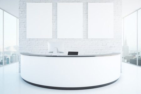 shiny floor: Modern white reception desk with three blank posters in interior with brick wall, shiny floor and panoramic windows with city view. Mock up, 3D Rendering Stock Photo