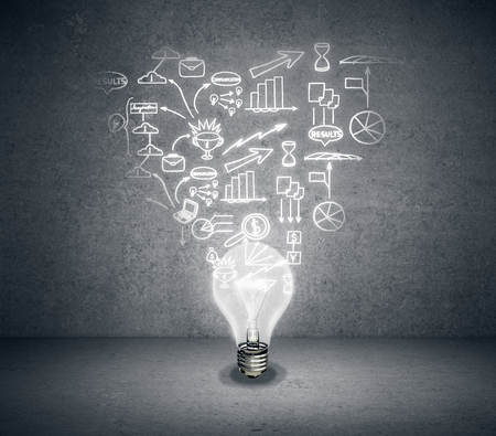idea bulb: Abstract light bulb with business sketch on concrete background. Business idea concept Stock Photo