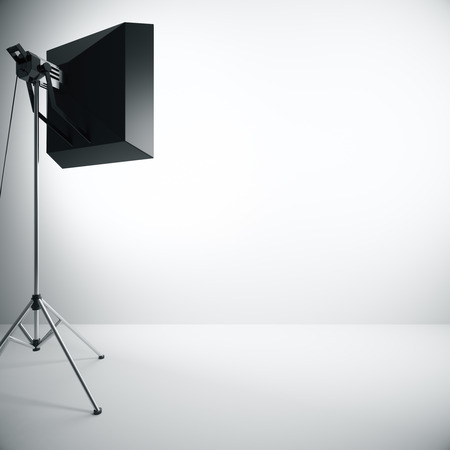 professional equipment: Empty concrete wall illuminated with professional lighting equipment. Mock up, 3D Rendering