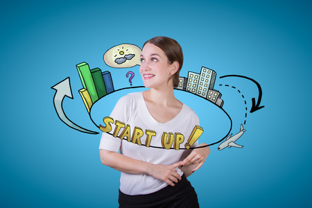 Gorgeous young lady with abstract circular start up sketch on blue background. Startup concept Stock Photo