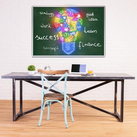idea sketch: Modern workplace with creative idea sketch on chalkboard