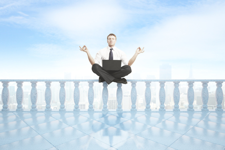 pillars: Young businessman with laptop meditating on concrete balcony pillars. City and bright sky background. 3D Rendering