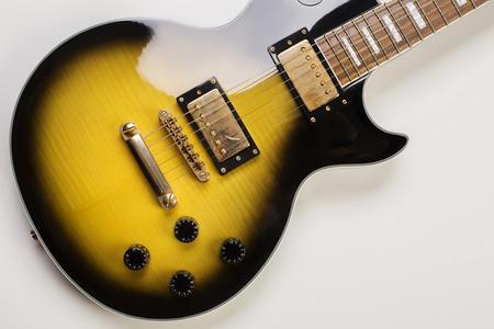 Closeup of shiny sunburst guitar on white background