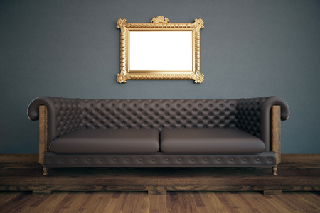 brown leather: Front view of luxurious interior with empty ornate picture frame, brown leather sofa, wooden floor and dark grey wall. Mock up, 3D Rendering Stock Photo