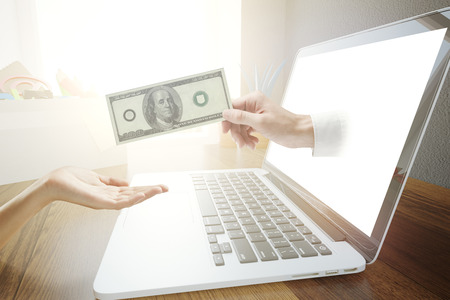 handing: Male handing dollar bill to female through laptop computer screen. Online banking concept. 3D Rendering Stock Photo