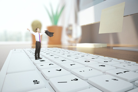 miniature: Abstract image of young businessman miniature celebrating success on white keyboard. Blurry workplace in the background. 3D Rendering Stock Photo