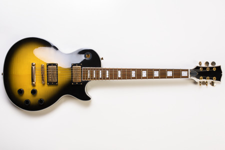 Top view of electric sunburst guitar on white background. Full length