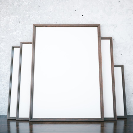 Room With Several Empty Picture Frames Leaning On Concrete Wall ...