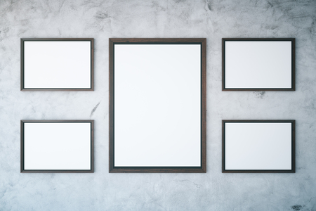 textured wall: Several picture frames hanging on textured concrete wall. Mock up, 3D Rendering