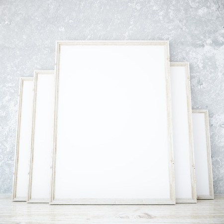 Room With Several Blank Picture Frames Leaning On Concrete Wall ...