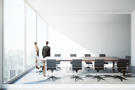 Thoughtful businesspeople standing in modern conference room interior with city view and daylight. Teamwork concept. 3D Rendering