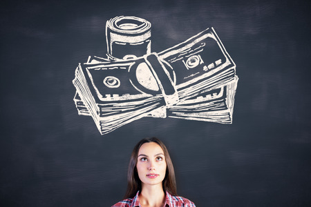 attractive woman: Portrait of attractive young woman on chalkboard background with money sketch Stock Photo