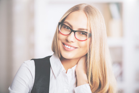 specs: Portrait of beautiful cheerful blonde woman in formal outfit and spectacles