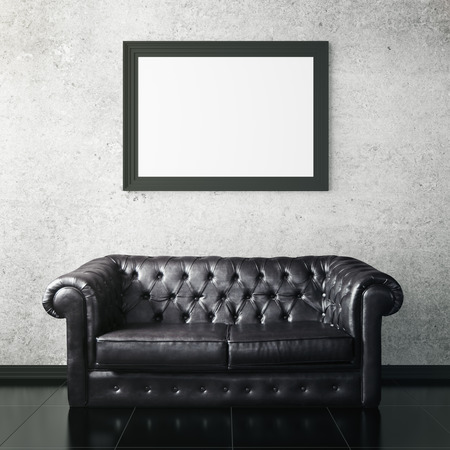 living room wall: Concrete interior with dark leather sofa and blank picture frame. Mock up, 3D Rendering Stock Photo