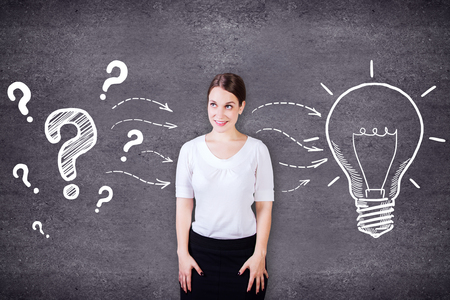 idea sketch: Attractive caucasian girl on concrete background with creative light bulb and question marks sketch. Idea concept