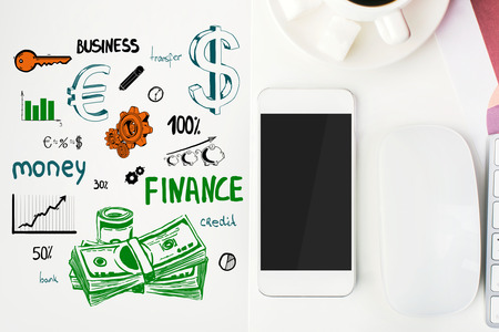 financial growth: Top view of office workplace with creative finance sketching, coffee cup, blank smartphone and other items. Financial growth concept