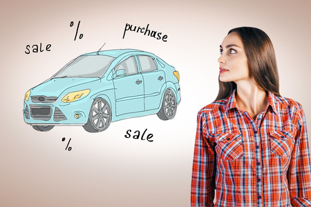 attractive woman: Attractive young woman looking at creative car sketch. Vehicle purchase concept Stock Photo