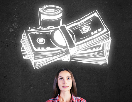 attractive woman: Portrait of attractive young woman on concrete background with money sketch