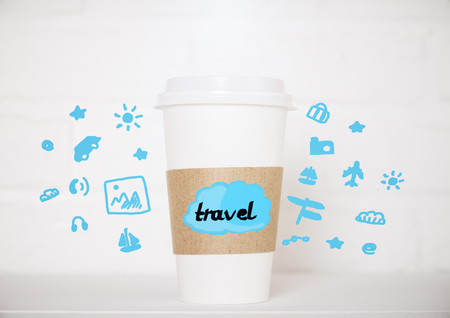 away travel: Close up of take away coffee cup with creative blue travel icons on blurry brick background. Traveling concept