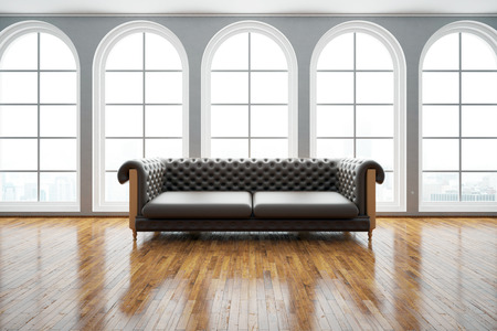 vintage furniture: Front view of dark leather sofa in bright room with wooden floor and windows with city view. 3D Rendering