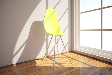 Close up of modern bright yellow chair in room with concrete wall, wooden floor and window with sunlight. 3D Rendering Stock Photo