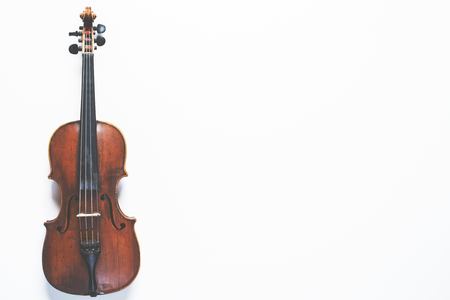 Top view of full length violin placed on white background copy space. Mock up