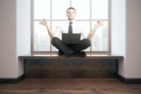 windowsill: Meditating businessman with laptop in interior. 3D Rendering