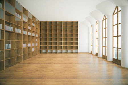 Library interior with empty wooden shelves, floor, concrete walls, ceiling, columns and windows with city view. 3D Rendering Stock Photo