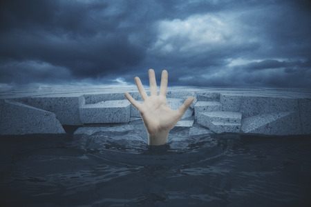 Hand of drawing man in sea seeking rescue on textured concrete blocks and dull sky background. 3D Rendering 스톡 콘텐츠