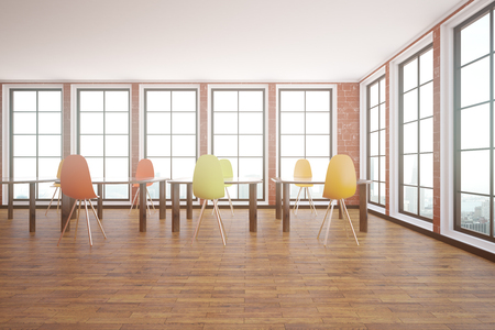 Red brick interior with wooden floor, windows with city view and tables with chairs. Classroom concept. 3D Rendering