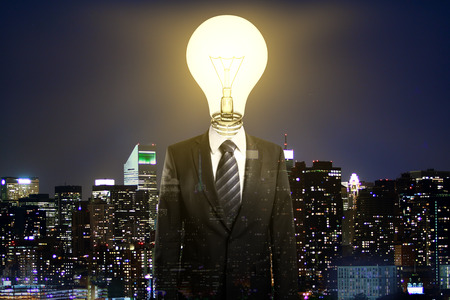 double headed: Abstract light bulb headed businessperson on night city background. Idea concept. Multiexposure
