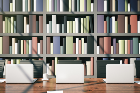 law library: Closeup of library table with laptops, coffee cup and daylight on bookcase background. 3D Rendering