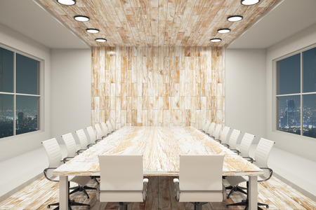 night view: Modern conference interior with blank wooden wall, equipment and night city view. Mock up, 3D Rendering Stock Photo