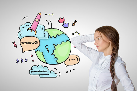 globe terrestre dessin: Attractive young woman looking at creative sketch with globe, rocket ship and other icons. Global technologies concept Banque d'images