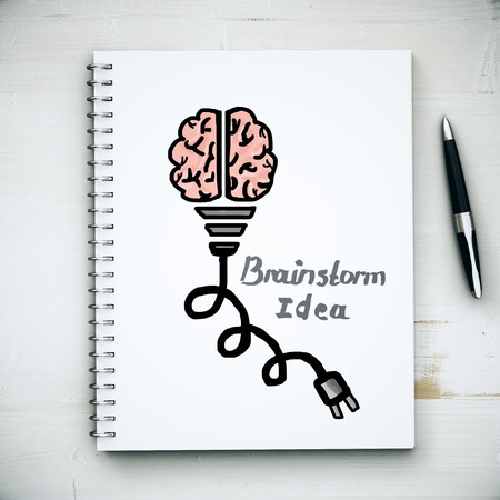 plug in: Top view of aged wooden desktop with creative pink brain with plug sketch in spiral notepad and pen. Brainstorm ideas concept. 3D Rendering