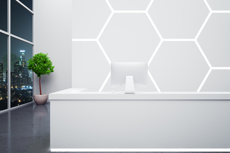 interior wall: Modern reception desk with computer in interior with honeycomb pattern on wall, decorative plant and night city view. 3D Rendering