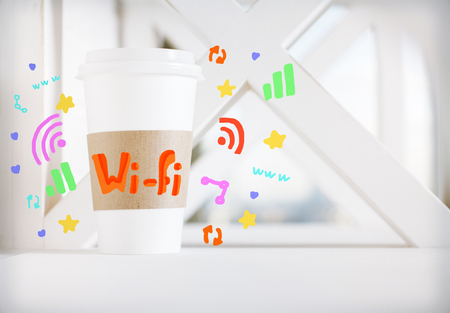 Take away coffee cup with wi fi and communications icons. Social media concept Stock Photo