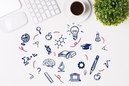 school computer: Top view of white desktop with creative science and education related icons, keyboard, coffee cup and other items. Knowledge concept Stock Photo