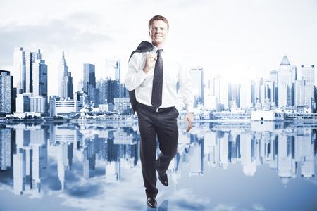 success man: Confident man walking on city background. Success concept Stock Photo
