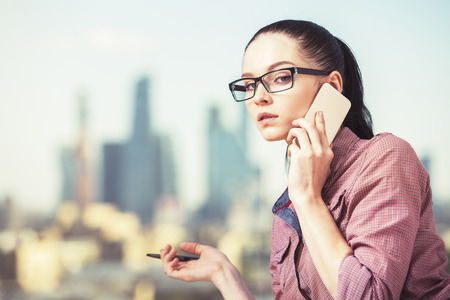 Close up portrait of attractive caucasian girl talking on phone. Communication concept
