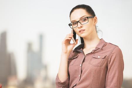 Close up portrait of attractive caucasian businesswoman talking on phone. Communication concept
