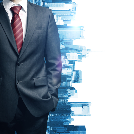 suit: Close up of business mans body in suit and tie on creative city background