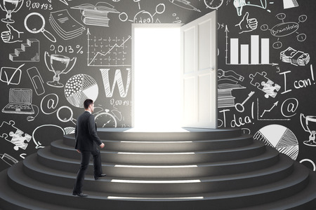 Businessman walking in abstract interior with stairs, open door with bright light and drawn business icons on wall. Success concept. 3D Rendering