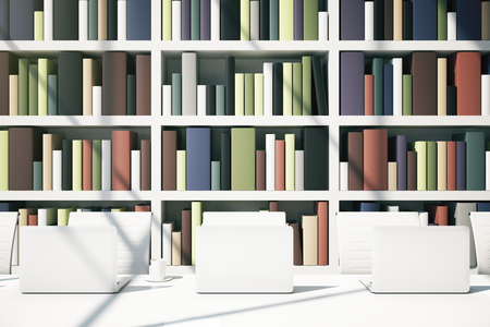 bookcase: Close up of white table with computer monitors on bookcase background. Library concept. 3D Rendering
