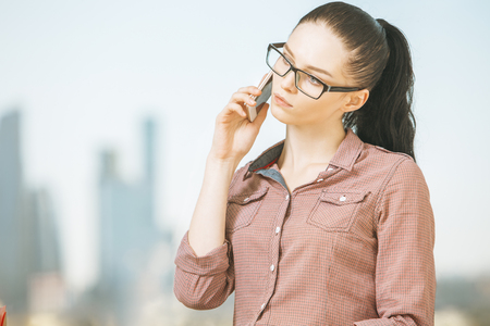 Close up portrait of attractive caucasian woman talking on phone.