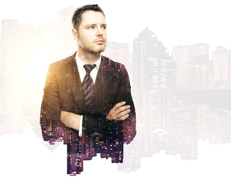 executive search: Thoughtful handsome business man on city background. Double exposure.