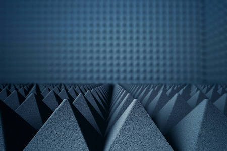 Abstract dark grey acoustic foam pyramids on dark background. 3D Rendering