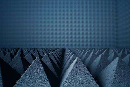 Abstrakt dunkelgrau Akustikschaum Pyramiden auf dunklem Hintergrund. 3D-Rendering Standard-Bild - 65975861