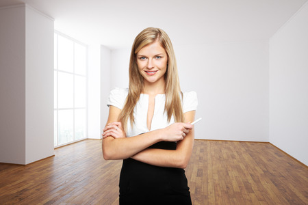 executive women: Confident smiling young woman in minimalistic interior Stock Photo