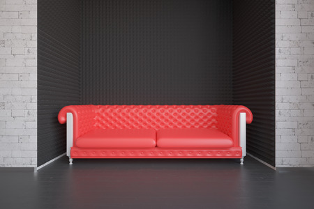 view of an elegant red couch: Modern interior with brick walls and red sofa. Relax concept. 3D Rendering